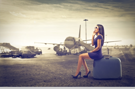20150512214749-businesswoman-woman-travel-plane-transportation-luggage-baggage